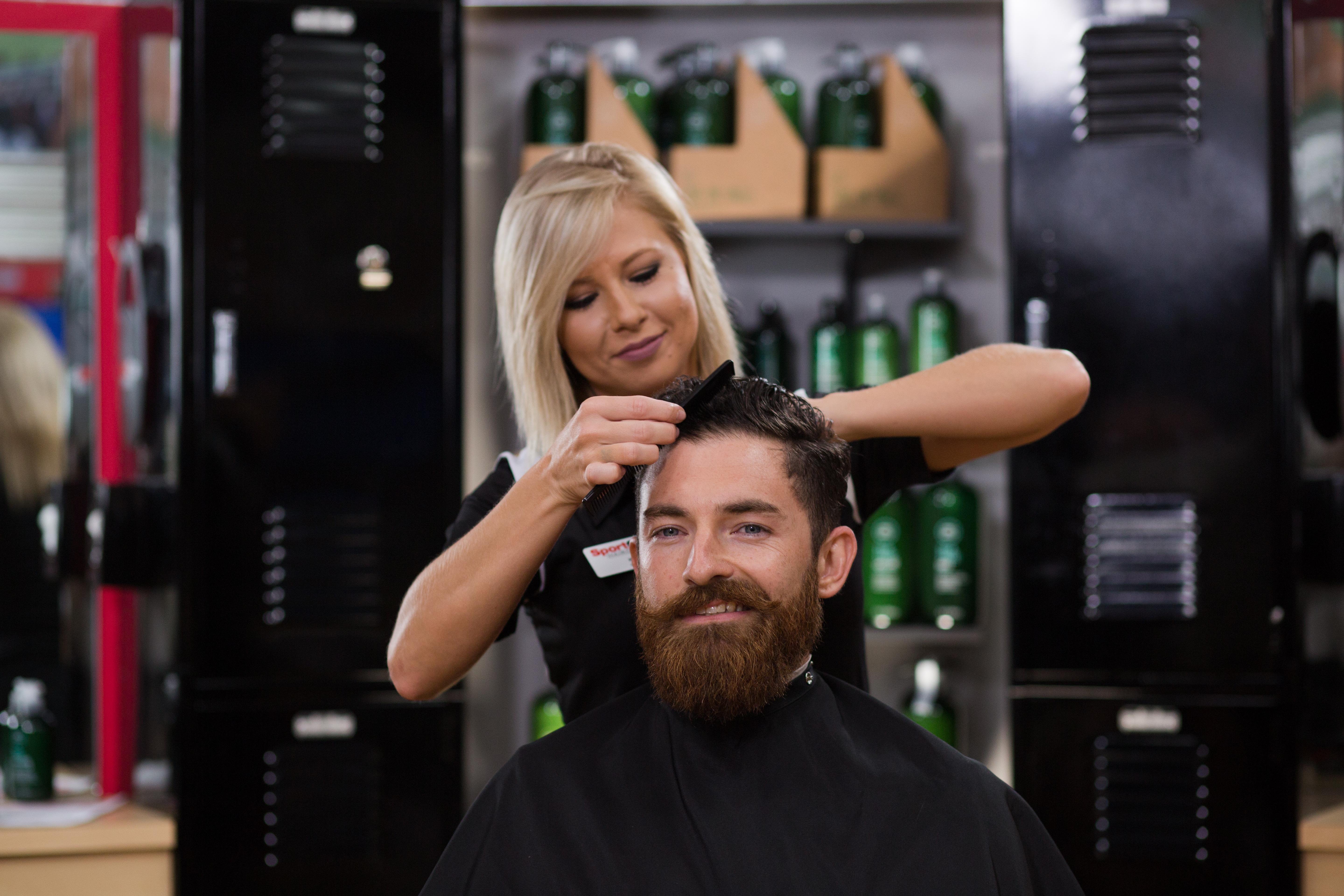Man with beard getting a Sport Clips haircut
