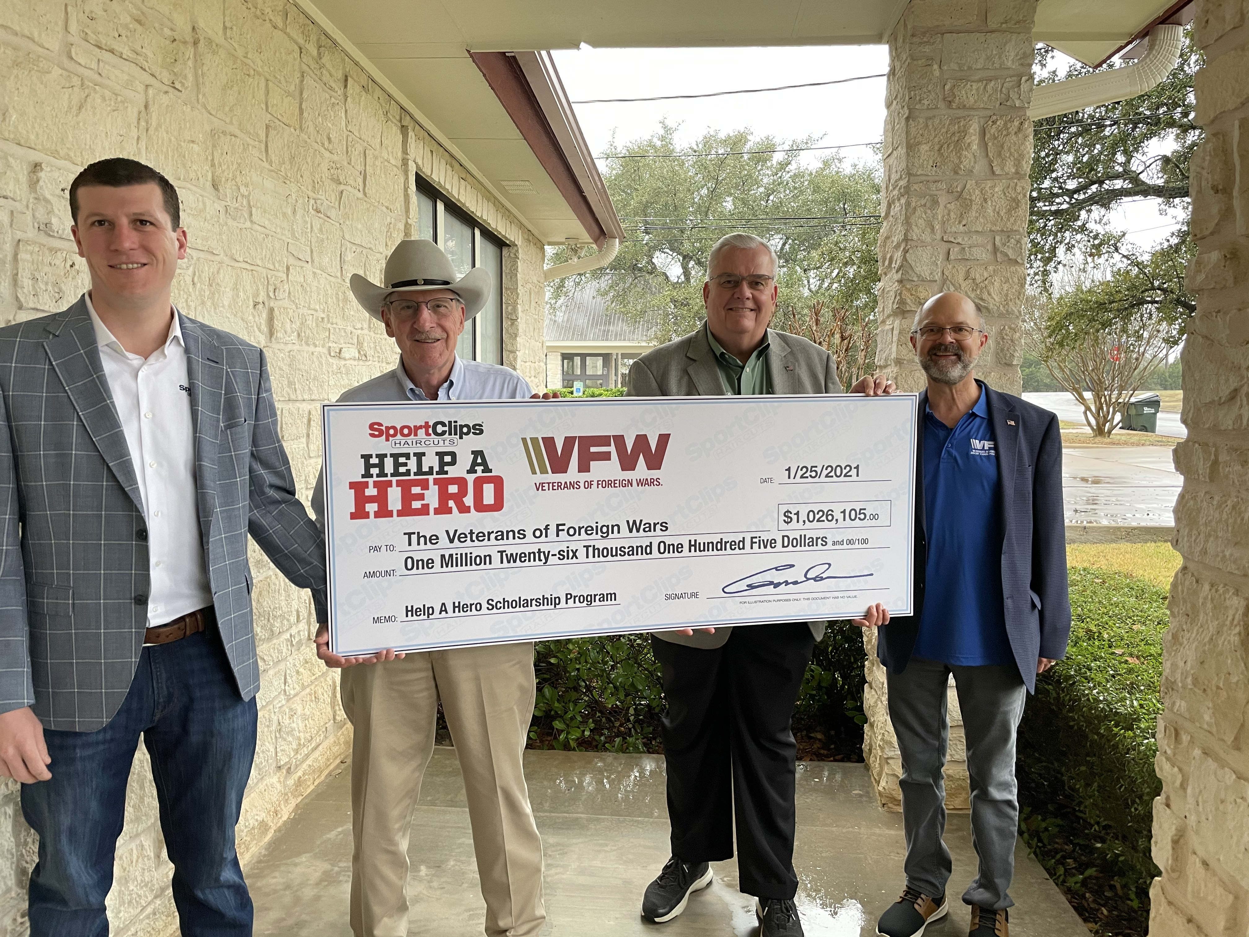 Edward & Gordan Logan Hold Donated Check for the VFW