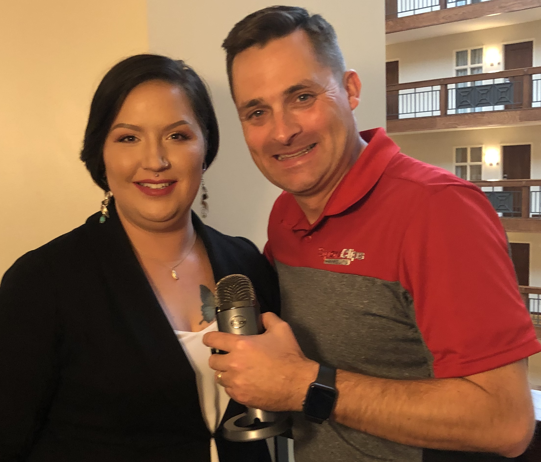 Chad Jordan and Colleen Foster holding a microphone