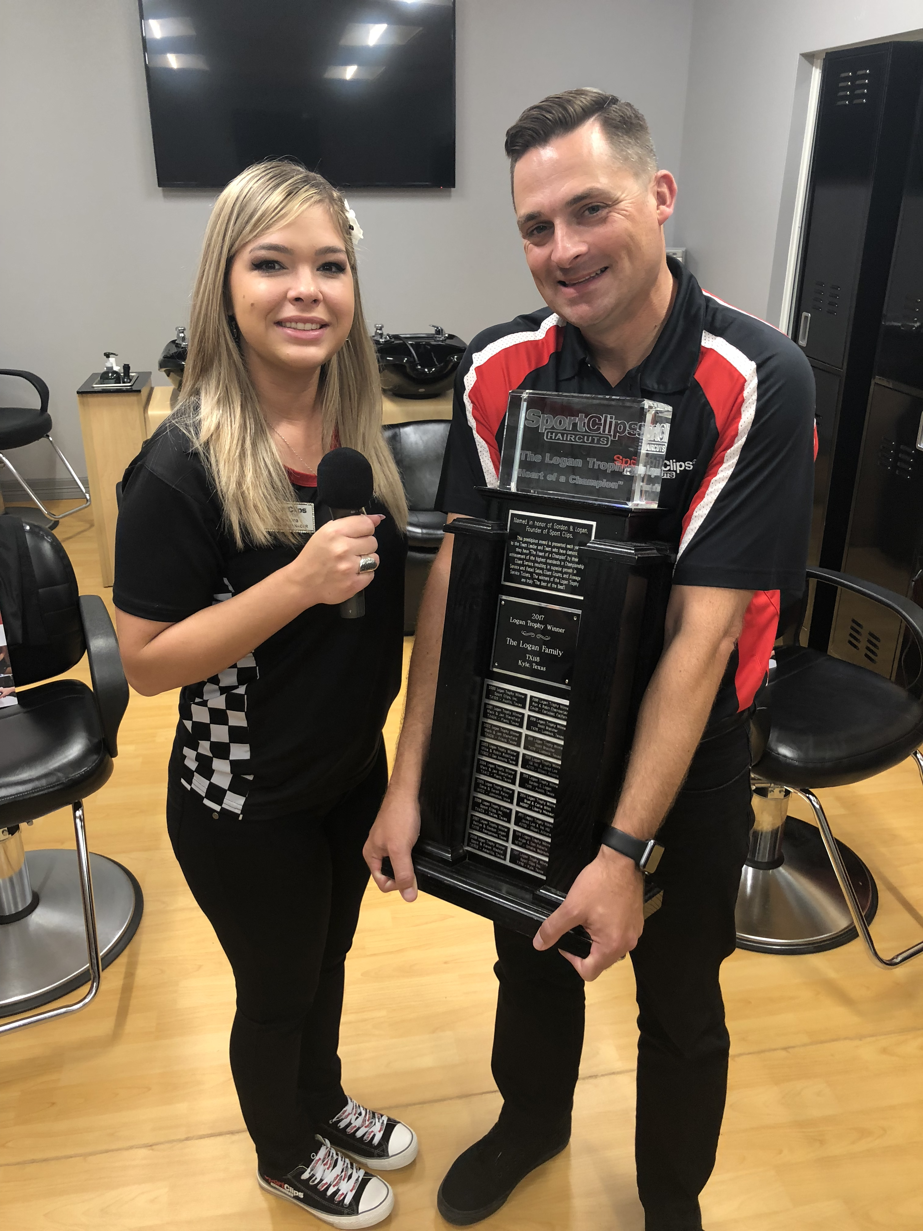 Christina and Chad holding the Logan Trophy.png