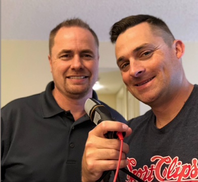 Jeff Burroughs and Chad Jordan Holding Podcast Microphone