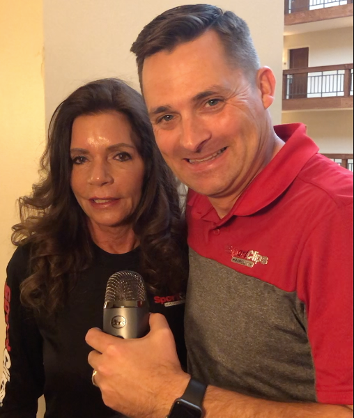 Chad Jordan and Judy Green holding a microphone