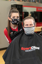 Stylist in mask with client in mask